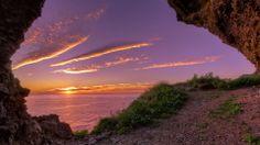 Magnificent Sunset Through A Coastal Cave HD Desktop Background wallpaper free