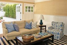 Natural-textured finishes like sea-grass carpet and grass-cloth wallpaper results in a comfortable—even elegant—indoor/outdoor family room.