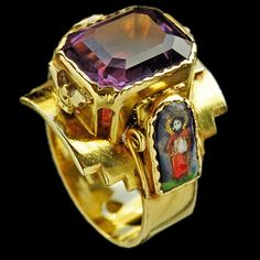 ECCLESIASTICAL Superb Arts & Crafts Ring  Gold Enamel Amethyst H: 2.2 cm (0.87 in)  W: 2.5 cm (0.98 in)  Marks: Monogram: 'GB' with a cross within a shield British, c.1910 Ring Case