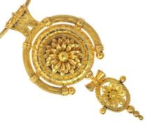 This elaborate Renaissance style pendant is designed by the house of Castellani and shows the finest technique in goldsmithing with exceptional detail in millegrain, granulation and woven gold encompassing a Renaissance Revival style characteristic of the original Castellani designs.