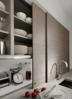 Storage Ideas to Steal from High-End Kitchen Systems Thin sliding cabinet doors in a kitchen by Germany company Beeck Kuchen conceal countertop clutter. Best Kitchen Cabinets, Kitchen Tops, Kitchen Cabinet Doors, New Kitchen, Kitchen Storage, 1960s Kitchen, Country Kitchen, Ranch Kitchen, Ikea Cupboards
