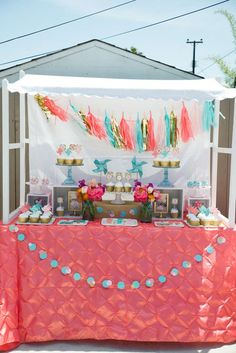 Coral and teal dessert table at a polka dots and pinwheels birthday party! See more party ideas at CatchMyParty.com!