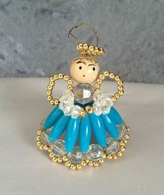 $12 -1960s Vintage Angel in a Blue Dress Beaded Christmas Ornament . . . Beautiful hand crafted beaded angel ornament with a halo, wings, and a lovely sky blue dress with a full, sweeping skirt. Smooth oblong, and faceted crystal beads!