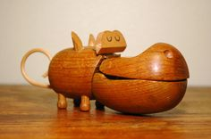 I love mid century modern design,but don't know a lot about it. This mid-century modern teak hippo is awesome!  I've never heard of the zoo line before... In my fantasy world, I'd be torn between having it as a decorative objet in my home or letting leftie keep it as it's intended for stowing jewelry.