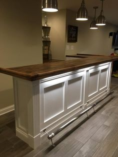 Home Bar with Bar Rail Molding, Fluted Columns & Trim Finished bars by woodworkers, DIYers and commercial builders using traditional Chicago style hardwood bar rails, bar top slabs & bar parts by Hardwoods Inc. Basement Bar Plans, Basement Bar Designs, Home Bar Designs, Basement Makeover, Basement Renovations, Home Remodeling, Basement Ideas, Home Bar Plans, Wet Bar Designs
