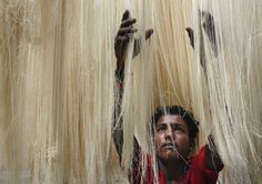An Indian worker dries vermicelli, used to make a traditional sweet dish popular during Ramadan, in Hyderabad, India, on <span>June 25, 2015</span>.
