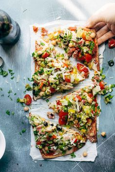 Chopped Salad Pizza - a tangy Italian-style chopped salad loaded on top of a crispy flatbread crust with tomato sauce and mozzarella. my favorite crunchy, tangy food for summer! | pinchofyum.com