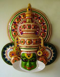 Kathakali: Its a kerala style cultural play: retells traditional, mythological and historical stories. They've even done Othello. Of course retold malayalee style. I love how their masks are painted, vibrant, charming and powerful.