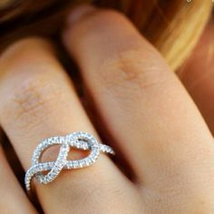 Diamond Infinity Ring- beautiful and meaningful. I think I would want one this as a right hand ring! Like the idea.
