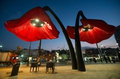 HQ Architects designed a floral sculpture that can change shape depending on the people passing below.  The  flowers are activated by the movement of people underneath, and the petals reaches nine meters in diameter.