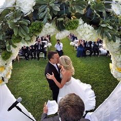 "You may now kiss the bride! Groom Brian Kamilar says of this special shot, ""My buddies hid a GoPro in the flowers of our wedding alter. We had no idea it was there, and before we got down the aisle they had posted it on online from their phone and tagged all our friends. Best day ever."" #GoPro #Wedding #Love"