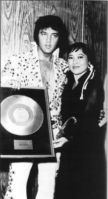 """Elvis receives Gold Record Award for """"Aloha from Hawaii"""" from Reiko Yukawa in Las Vegas - August 8, 1973"""
