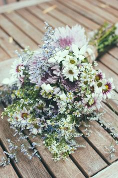 I like this wildflower bouquet. The purples and blues would look best with my color scheme