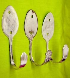Great use for old odd spoons. Just pound, bend and drill.