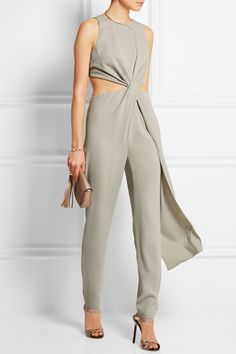Halston Heritage | Cutout crepe jumpsuit | For its Spring '15 runway, Halston Heritage was inspired by the modern ease of founding designer Roy Halston Frowick's creations. This light-gray crepe jumpsuit has a twisted front to accentuate the waist-defining cutout sides. The draped panel creates beautiful movement with every step.