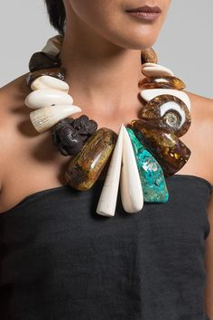 $6,550.00 | Monies UNIQUE Amber, Mammoth, Malachite, & Ammonite Necklace | Handcrafted in Denmark, Monies jewelry is bold in design and strong in aesthetic. This Monies necklace is made with Amber, Mammoth, Malachite, Ammonite, Leather, and Ebony, to become a one-of-a-kind and edgy statement piece. Monies is sold online and in-store at Santa Fe Dry Goods & Workshop in Santa Fe, New Mexico.