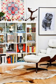 eames lounge chair, cowhide rug and pug art? yes, please!