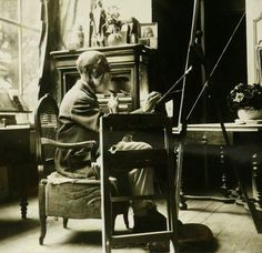 Photo of artist Edgar Maxence (French, 1871–1954) at his easel