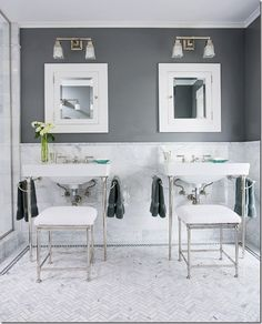 Gray + White  Cool, clean, and classic, this neutral color scheme treats gray as an accent color on the floor and in veined marble wainscoting. Texture plays a big part in this traditional room's ambience.
