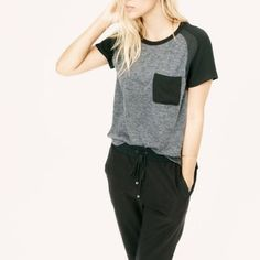 Lou & Grey Pocket Tee NWOT LOFT Lou & Grey Mixup Tee in charcoal and black.  Introducing a new line of easy, texture-rich pieces for your every day. From the soft knit front, woven back and shimmery shoulder trim, our designers love this play on matte and shine. Crew neck. Short sleeves. Patch chest pocket. Side slits. 77% Polyester, 19% Rayon, 4% Spandex. LOFT Tops