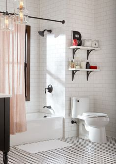 Classic subway tiled walls and hex-pattern flooring ground this bathroom in iconic style.