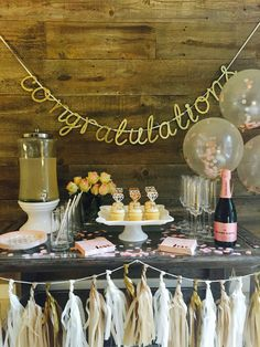 "Elegant blush + gold bridal shower decor idea - ""Congratulations"" banner with tassels, balloons and pink ""love"" napkins {Courtesy of Soigne Party}"