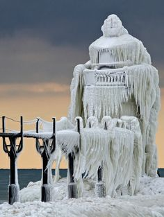 Shards of ice encase the St. Joseph, Mich., North Pier Outer Lighthouse on Lake Michigan after a late January storm . . .