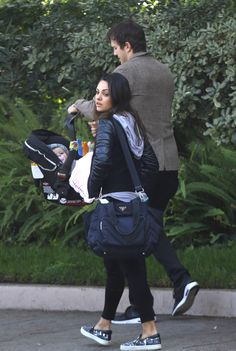Ashton Kutcher and Mila Kunis enjoy a day out with baby girl Wyatt and parents