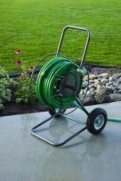 A rugged all-terrain hose cart that doesn't kink hoses and won't leak, break or rust after only a few short years! The 2-Wheel EZ Hose Cart. | GardenersEdge.com