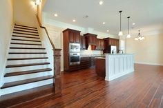 #TheBaileyII is a versatile plan that can be built with 3-6 bedrooms. The custom #woodstaircase in this home is stained a dark walnut.