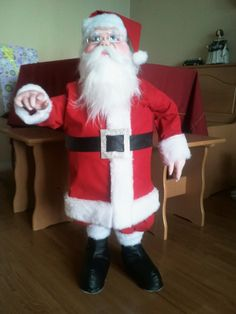 "For this Christmas I made this Santa, I wanted it to be big, so is 36 ""tall, his face is made of fabric and foam body with a wire skeleton"