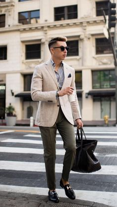 - with a business casual combo idea with a blue striped button up shirt white blazer green pocket square olive trousers black loafers black bag wrist accessories sunglasses Edgy Work Outfits, Business Casual Outfits, Casual Fall Outfits, Mens Fashion Blog, Mens Fashion Suits, Fashion Edgy, Work Fashion, Daily Fashion, Smart Casual Men