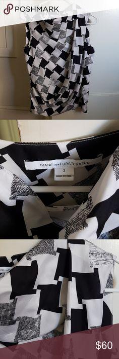 Diane von Furstenberg assymetric silk top Assymetric folds drape across the front. Giant hounds tooth pattern. Very elegant Diane von Furstenberg Tops Blouses