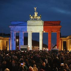 In the aftermath of the #Paris attacks, the Brandenburg Gate in Berlin and buildings around the world lit up with the French colors in a show of solidarity and support. (Sean Gallup/Getty Images)