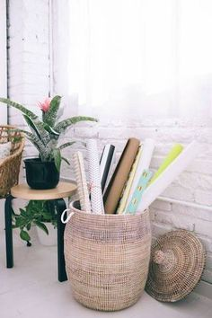 Storage Basket Ideas - An actually pretty way to corral those wrapping paper rolls