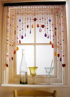 I am in love and think this would be fabulous in my kitchen window and the playroom. I am not crafty. :( Any idea where to find this? Sadly I think it might be something that you would have to make. I have seen it called a room divider and curtain, but I dont want a curtain that is long, I like that...