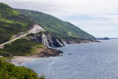 With dramatic coastlines, waterfalls, vibrant bays and beaches, it's easy to see why Canada's Cabot Trail is considered one of the world's best road trips. East Coast Travel, East Coast Road Trip, Nova Scotia Travel, Cabot Trail, Canada North, Atlantic Canada, Visit Canada, Cape Breton, Canada Travel