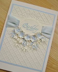 emboss folder background, wide ribbon, leaf punch and cut out flowers