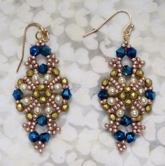 Lady Jane earrings by Deb Roberti. In person, the golds match. I like this pattern. I think I may make the bracelet.