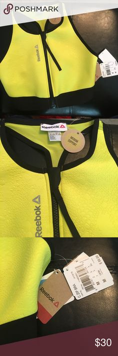 Reebok Sports Bra Beautiful bright yellow polyester and spandex sports bra. It has a full front zip and a beautiful pattern in the fabric. It has a mesh back and is of medium support. Speedwick will ensure you stay dry and comfy!  Size medium. New with tags and retails for $55 Reebok Tops