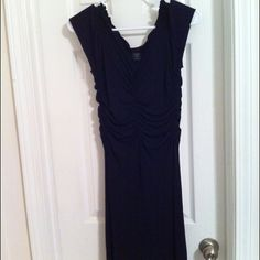 Perfect Little Black Dress!! Gorgeous on. Stretchy material. Absolutely in love with this dress but its too small on me now...and after 3 kids don't think I'll go back to a 2!! Can't remember how much I paid for this but I know i paid full from Express. Comes from a smoke free pet free home ☺ Express Dresses