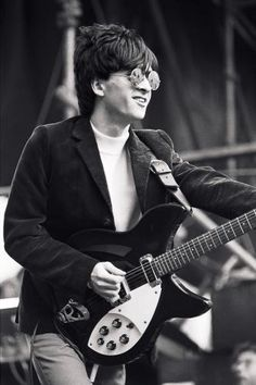Johnny Marr playing his Rickenbacker on stage with The Smiths at the GLC 'Jobs For A Change' Festival, Jubilee Gardens, London. June 10, 1984.