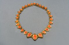 Carved Coral Gold Link Necklace c1870   From a unique collection of vintage link necklaces at https://www.1stdibs.com/jewelry/necklaces/link-necklaces/