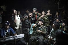 Julius Schrank, a German photographer working for De Volkskrant won 1st Prize Daily Life Single category of the 2014 World Press Photo contest with this picture of Kachin Independence Army fighters drinking and celebrating at a funeral of one of their commanders who died the day before, in Burma, taken March 15, 2013.