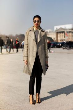 caroline issa is adorable. I like all of the layers and colors. Tailoring is nice. I don't think I'd wear the peep-toe boots, but she's rocking them. Sun glasses are a cool shape.