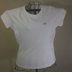 New Balance White Shirt Sz Lg Very good condition New Balance Shirt sz Lg. I do offer discount bundling so check out my other items. Thanks for stopping by. New Balance Tops