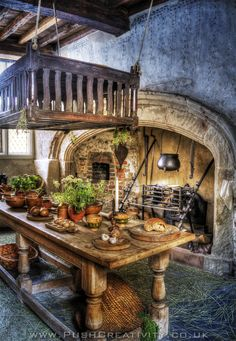 The Tudor kitchen at Plas Mawr, Conwy, Wales. The large hearth and the kitchen island are fantastic. Since I do not want a lot of cabinetry, a simple look like this would work.