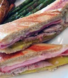 Cuban sandwich/sándwich Cubano, the one you ate in Miami! Roast pork, delectable ham, and melted Swiss cheese. Three Guys. Hundreds of recipes. On the web since 1996.