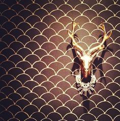 White Faux Taxidermy deer over wallpaper. I own the Edmonton. And want them all!!!!