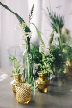green and gold centerpieces - photo by Echard Wheeler Photography http://ruffledblog.com/modern-styled-engagement-party